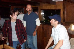 "Actors Pia Thrasher and Mike Burnell on the set of ""Reagan's Wharf"" with director Bryan Ott"